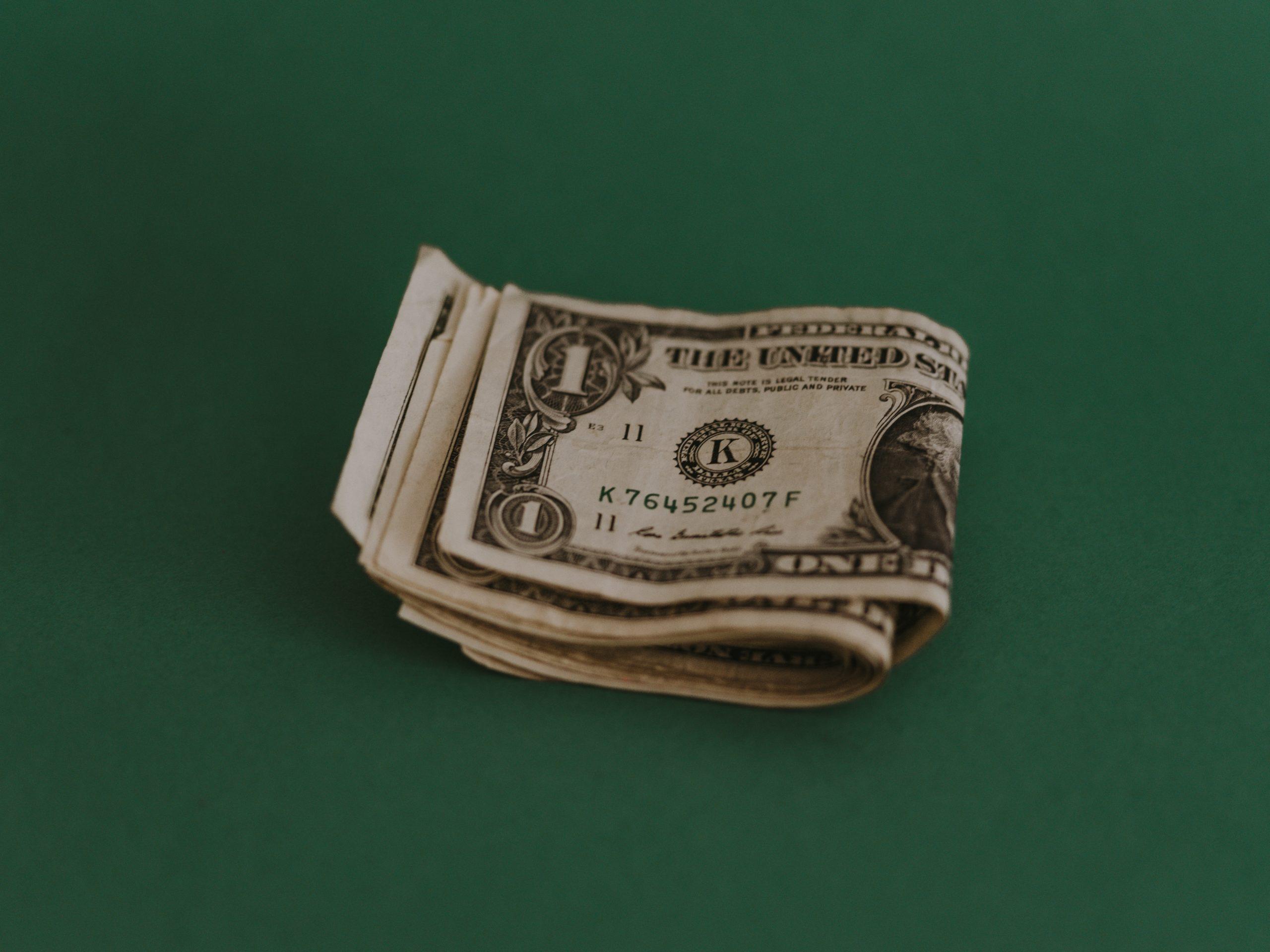 Dollar bills on green background